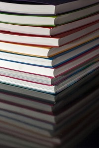 Photo Credit: Stack of Thin Flexicover Books On Reflective Table by Horia Varlan