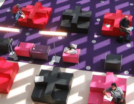 Caption: Reading at Seattle Library on Tetris Chairs by Christopher Patterson